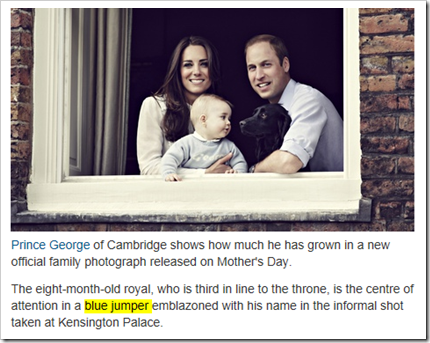 foto del principe George con la didascalia Prince George […] is the centre of attention in a blue jumper emblazoned with his name