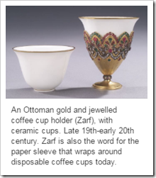 An Ottoman gold and jewelled coffee cup holder (Zarf), with ceramic cups. Late 19th-early 20th century. Zarf is also the word for the paper sleeve that wraps around disposable coffee cups today.