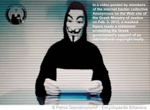 [foto di un membro mascherato di Anonymous] Didascalia: In a video posted by members of the Internet hacker collective Anonymous on the Web site of the Greek Ministry of Justice on Feb. 3, 2012, a masked figure reads a statement protesting the Greek government's support of an international copyright treaty.